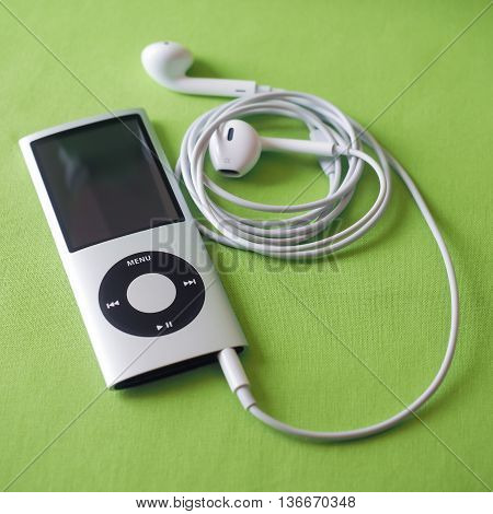 BERRY AUSTRALIA - June 23 2016 : An Apple iPod Nano 4th generation in silver with Apple Earpods attached.