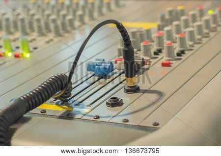 Audio jack and wires connected Audio Mixing Console