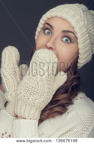 portrait of a girl in white winter hat and sweater