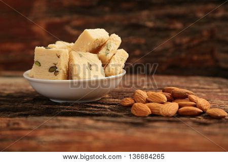 Teraditional Indian sweet Soan halwa served with Almonds, poster