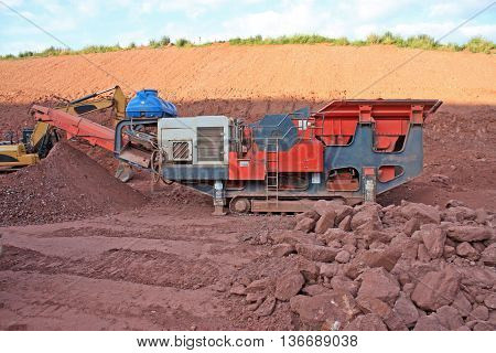 Mobile stone crusher on a road construction site