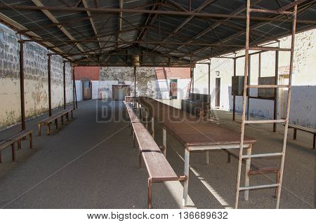 FREMANTLE,WA,AUSTRALIA-JUNE 1,2016:  Outdoor yard at the Fremantle Prison with tables and benches in Fremantle, Western Australia.