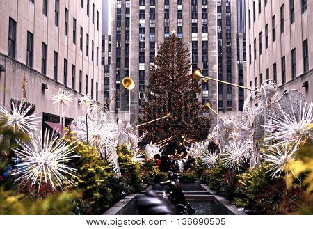 NEW YORK, USA - DECEMBER 9, 1994 - GE building in the Rockefeller Centre at Christmas with angels browing trumpets in the foreground New York USA, December 9, 1994.