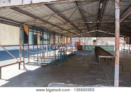FREMANTLE,WA,AUSTRALIA-JUNE 1,2016:  Fremantle Prison yard exercise area and shelter with tables in Fremantle, Western Australia.