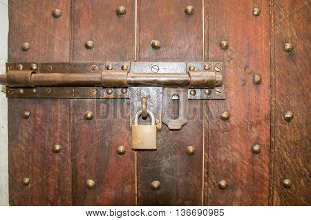 FREMANTLE,WA,AUSTRALIA-JUNE 1,2016:  Prison door detail with brass lock and bolted door in the historic Fremantle Prison in Fremantle, Western Australia.