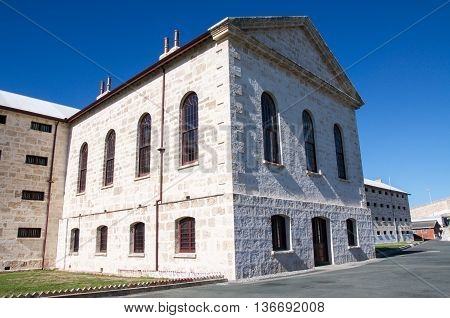 FREMANTLE,WA,AUSTRALIA-JUNE 1,2016: Old arched windows in the limestone architecture at the Fremantle Prison under a clear blue sky in Fremantle, Western Australia.