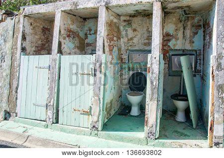 FREMANTLE,WA,AUSTRALIA-JUNE 13,2016: Outdoor weathered toilet area at the Fremantle Prison in Fremantle, Western Australia.