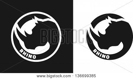 Silhouette of an rhino, monochrome logo on dark and white background.