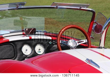 Durban, South Africa -  May 02, 2015: Red dashboard of old model sport car AC Cobra at the festival Highland Gathering. Vintage car style.