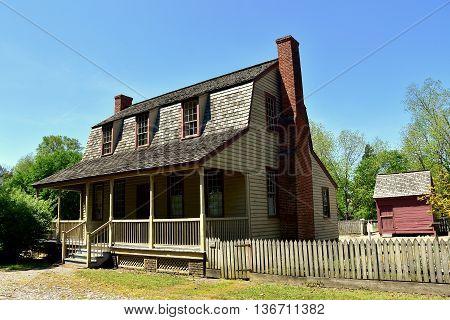 Bath North Carolina - April 25 2016: 1790 Van Der Veer Dutch colonial Home with gambrel roof and front porch