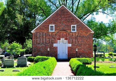 Bath North Carolina - April 25 2016: Historic 1734 St. Thomas Episcopal Church surrounded by gravestones is the oldest church in the state *