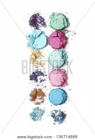 Smashed colorful eye shadow make up palette isolated on a white background