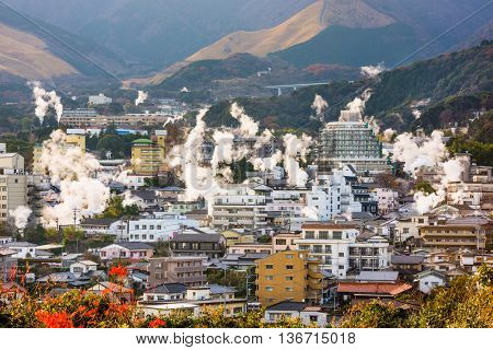 Beppu, Japan cityscape with hot spring bath houses.