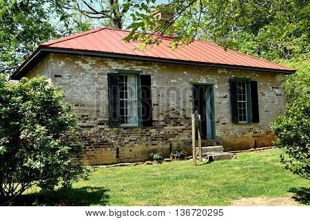 Hillsborough North Carolina - April 20 2016: Two room brick schoolhouse at the 1821 Burwell School for Women Historic Site
