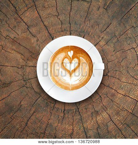 Top View Latte Art Coffee On Tree Stump Texture Background