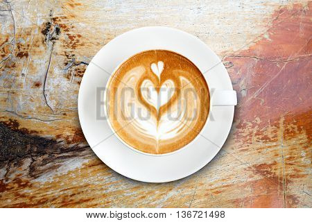 Top View Latte Art Coffee On Wood Background