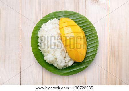 Dessert Sweet Sticky Rice With Mango Coconut Milk On Wood