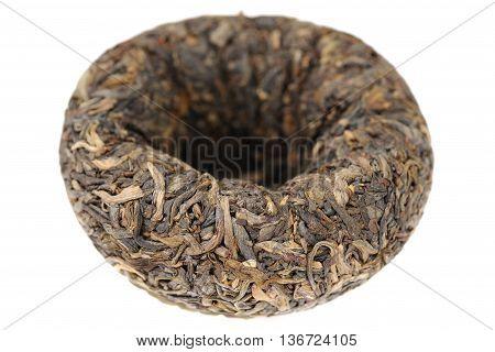 Raw green puerh tea bowl shape tuo cha closeup isolated