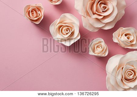 Beautiful fondant pink roses on bright pink background
