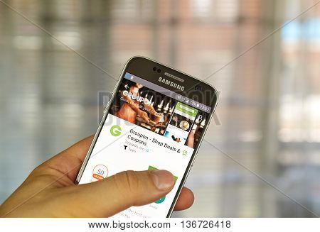 MONTREAL CANADA - JUNE 24 2016 : Groupon android application on Samsung S7 screen. Groupon connects millions of subscribers with local merchants by offering activities travel goods and services.