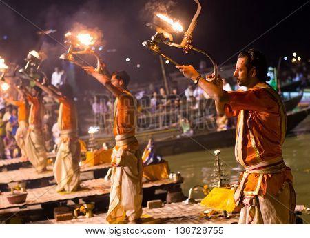 A Hindu Priest Performs The Ganga Aarti Ritual In Varanasi.
