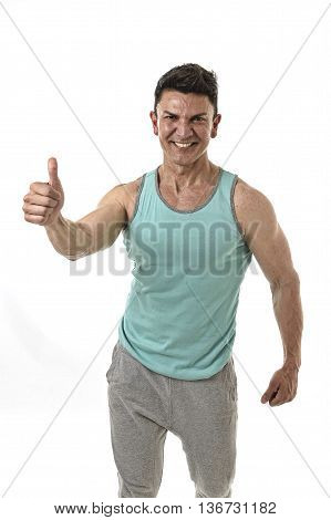 40s attractive hispanic sport man and bodybuilder smiling happy in corporate pose giving thumb up wearing singlet having very fit and muscular body in mature bodybuilding and body care isolated