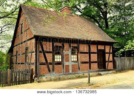 Old Salem North Carolina - April 21 2016: Half-timber and brick 1768 Moravian Fifth House with 1805 alterations on Main Street