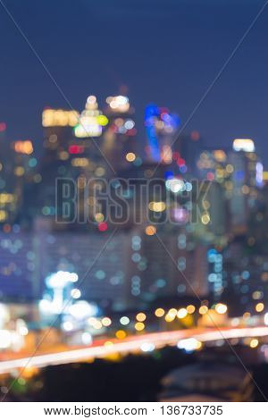 Abstract blurred lights night view, city office building and raod