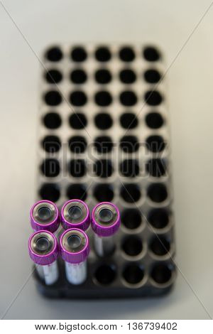 Close-up detail of EDTA test tubes used to collect blood. Abstract medical equipment concept.