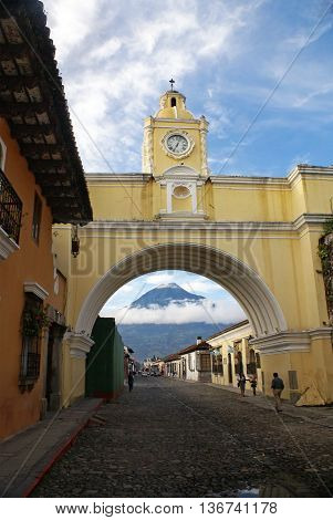 ANTIGUA GUATEMALA GUATEMALA - SEPTEMBER 302015: Volcano view through the Santa Catalina Arch in Antigua Guatemala