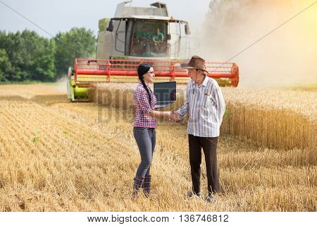 Man And Woman Shaking Hands At Harvest