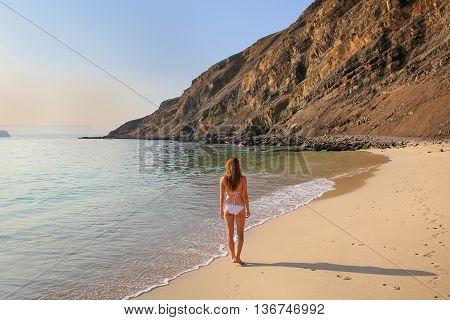 Young Woman In Bikini Standing At La Mina Beach In Paracas National Reserve, Peru