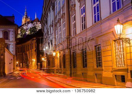 Prague Old Town Street with Illuminated Prague Castle Prazsky Hrad.