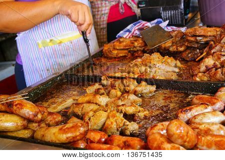 Meat Is Being Cooked For Asado At Mercado Cuatro In Asuncion, Paraguay