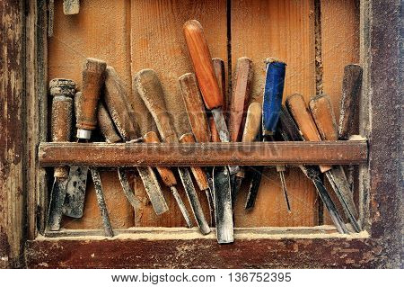 Tools for woodcarving on the shelf in the studio