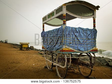 Mobile stalls along sandy beach in Pondicherry South India.