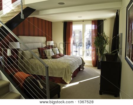 Loft Bedroom with red wall