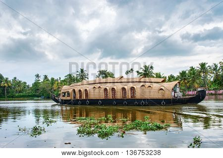 Traditional Indian houseboat near Alleppey on Kerala backwaters India