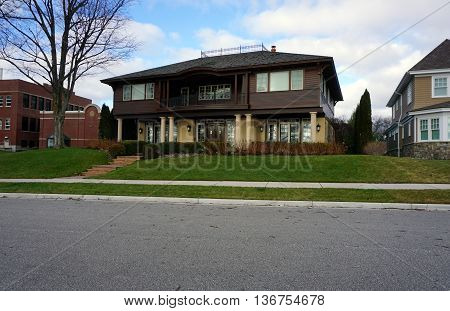 HARBOR SPRINGS, MICHIGAN / UNITED STATES - DECEMBER 25, 2015: A large brown mansion on East Bluff Drive in Harbor Springs, Michigan, with a view of Little Traverse Bay.