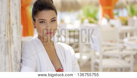Sultry looking woman at empty outdoor restaurant