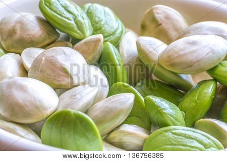 Parkia speciosa ( petai bitter bean twisted cluster bean stinker or stink bean) with white cup and spoon