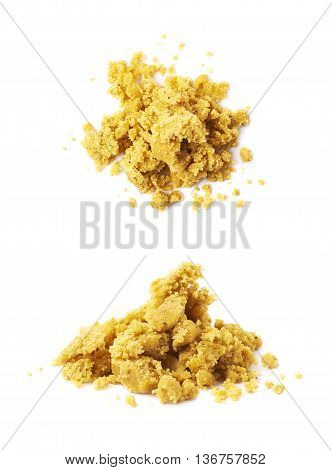 Crushed yellow bouillon stock broth cube isolated over the white background, set of two different foreshortenings