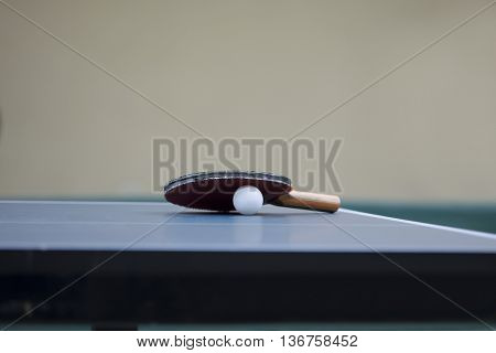 Table Tennis racket and ball on a Table Tennis Table - Focus at the Racket/Blade and shallow DOF