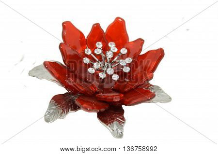 Red flower brooch isolated on white background