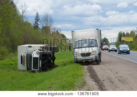 LENINGRAD REGION, RUSSIA - MAY 17, 2015: Overturned truck GAZ-3309 lies on the side of the road