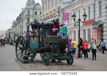 KAZAN, RUSSIA - APRIL 30, 2016: Children are photographed on a copy of the carriage of Empress Catherine II on the street Bauman. Tourist landmark of the city Kazan