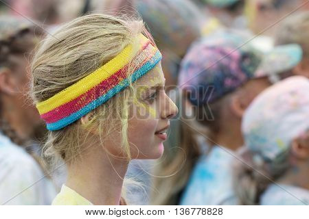 STOCKHOLM SWEDEN - MAY 22 2016: Head of young blonde woman wearing bandeau covered with color powder in the Color Run Event in Sweden May 22 2016