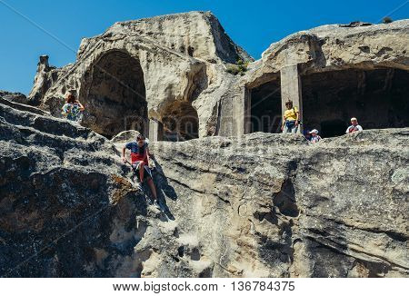 Uplistsikhe Georgia - July 21 2015. Tourists in ancient rock-hewn town called Uplistsikhe in Georgia