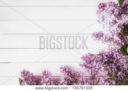 Beautiful lilac flowers on vintage white wooden background with copy space for text with dreamy shabby chic tone. Great mock up/template for post cards, gift cards, greeting cards at weddings for design / websites.