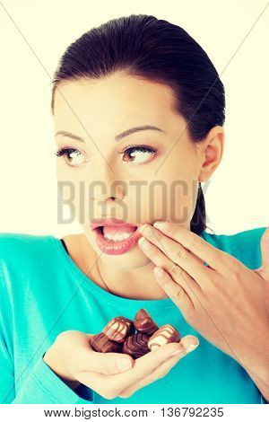 Embarrassment woman with chocolates